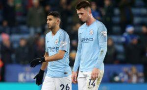 Pemain Manchester City, Riyad Mahrez (kiri) dan Aymeric Laporte (kanan) positif covid-19.